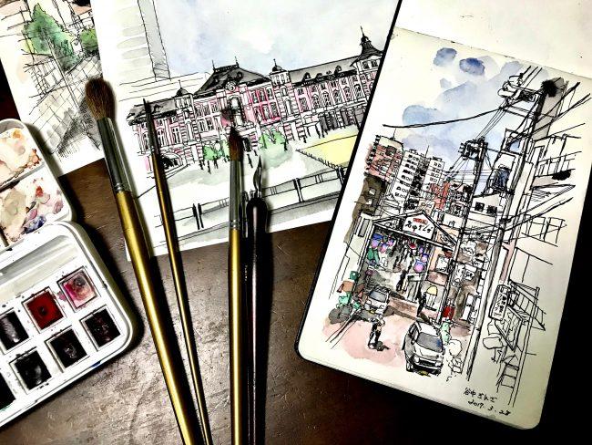 ジュエリーデザイナー岡田訓明が描いた風景画と筆、ペンを撮った写真